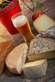Cheeses And Tomme De Savoie With Glass Of Beer, French Cheese Savoy, French Alps France. poster