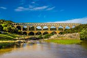 Roman Aqueduct Pont Du Gard Over Gardon River - Nimes, France, Europe poster