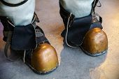Close-up Shoes Of An Old Vintage Three-bolt Deep-sea Diving Suit. Suit For Deep Sea Diving Of The La poster