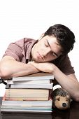 Teen Male Sleeping On Books