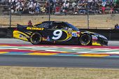SONOMA, CA - JUN 24, 2012:  Marcos Ambrose (9) brings his car through the turns during the Toyota Sa