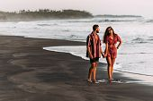 Happy Couple Holding Hands Walking On The Sandy Beach. Couple In Love At Sunset By The Sea. Couple I poster