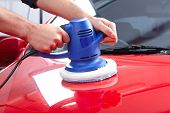 Hands with Auto polisher. Car repair service.