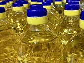 Sunflower Oil In Plastic Bottles With Bright Caps. A Lot Of Bottles With Clear Vegetable Oil. Busine poster