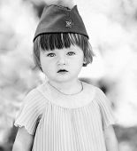 Black And White Photo Of A Cute Little Girl In A Soldier's Caps