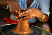 stock photo of molding clay  - potter making a new clay pot manufacture by method of handicrafts - JPG