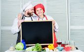 Family Values. Share Joy. Man And Woman Chef Cooking Food Together. Couple With Blackboard For Adver poster