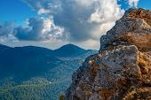Beautiful Mountains Aerial Landscape View. Mountain Peak Of Rocks Covered By Clouds And Fog. Mountai poster