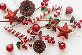 Christmas White Wood With Pine Cones Or Conifer Cone, Red Holly Balls, Glitter Star, Candy Cane And  poster