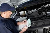 image of internal combustion  - Professional car mechanic working in auto repair service - JPG