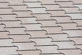 foto of interlocking  - Interlocking asphalt roof shingles for construction background - JPG