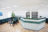 picture of premises  - Interior of a waiting room with a table of reception - JPG
