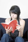 Young Trendy Woman Reading A Foreign Language Book