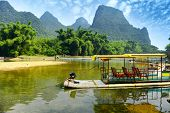 stock photo of raft  - Bamboo rafting in Li River - JPG