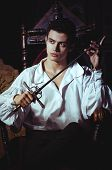image of aristocrat  - Portrait of a romantic man with a sword - JPG