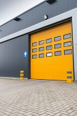 Yellow Loading Door In Industrial Warehouse