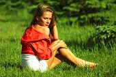 young sommer woman on green grass