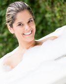 Portrait of beautiful woman taking a bath.
