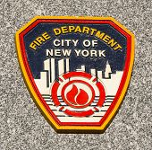 FDNY emblem on fallen officers memorial in Brooklyn, NY.
