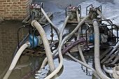 image of flood  - Industrial water pumps in pumping advancing floods - JPG