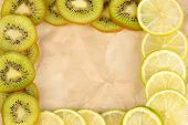 Lime and kiwi fruit slices frame on color background