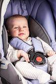 Cute little boy in car seat