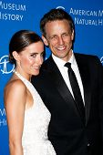 NEW YORK-NOV 21; Comedian Seth Meyers (R) and wife Alexi Ashe attend American Museum of Natural Hist