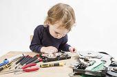 Child Repairing Hard Disk Drive