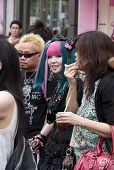 A Young Subcultural Couple Standing In The Crowd In Harajuku District, Tokyo.