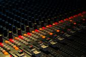 stock photo of low-light  - a music mixer in studio closeup - JPG