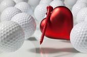stock photo of glass heart  - White golf balls and red heart on a glass table - JPG