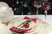 Beautiful Christmas Table Setting In Front Of Christmas Tree, With Red Crystal Wine Goblet Glasses