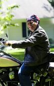 Middle Age Man On Motorcycle With American Flag Bandana