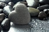 stock photo of pumice stone  - Grey stone in shape of heart - JPG