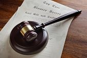 Gavel and legal papers last will and testament, divorce decree and tax law concept for the judicial