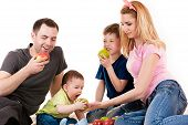 Caucasian family with children eating apples