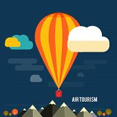 Hot Air Balloon Flying Over The Mountain