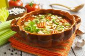 foto of italian parsley  - Minestrone italian vegetable soup with pasta on the table - JPG