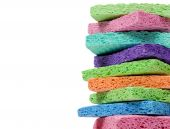 Stack Of Multi-colored Sponges On White With Copy Space