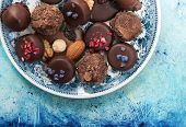 stock photo of truffle  - Assortment of fine chocolates dark and milk chocolate and truffle - JPG