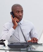 Afro-american Businessman On Phone In The Office
