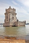 LISBON, PORTUGAL - SEPTEMBER 28, 2011: The famous Tower of Belem in water of river Tagus. White marb