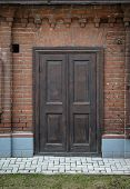 Old, Vintage, Wooden Door In A Brick Wall.