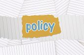 The word policy against lined paper strewn over surface