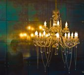Crystal Chandelier Lighting Near The Mirror Wall