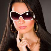 stock photo of saxy  - Girl with stylish white glasses  studio shot - JPG