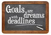 Goals are dreams with deadlines - motivational phrase on a vintage blackboard