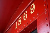 picture of caboose  - A red caboose dated 1869 in the San Juan Capistrano Los Rios Historic District - JPG