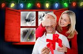 Loving couple with gift against santa delivery presents to village