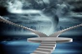 Winding stairs against stormy sky with tornado over road
